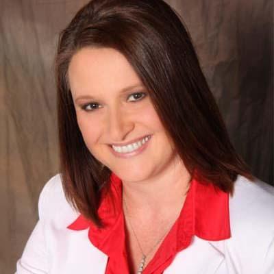 Dr. Andrea Blythe working at BLVD Dentistry & Orthodontics